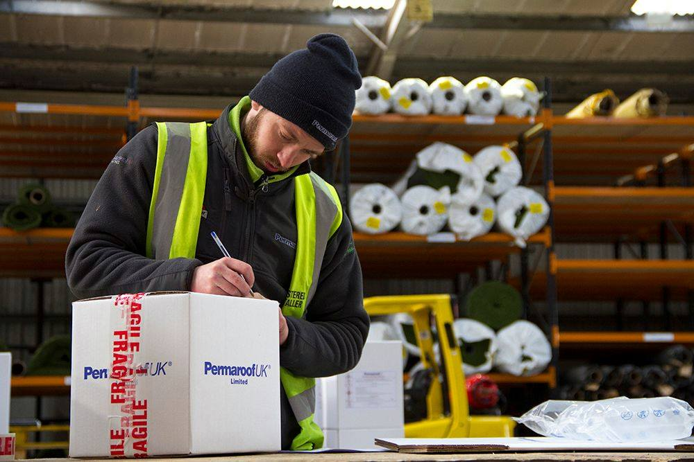 Permaroof Warehouse Staff | Packing EPDM Roofs
